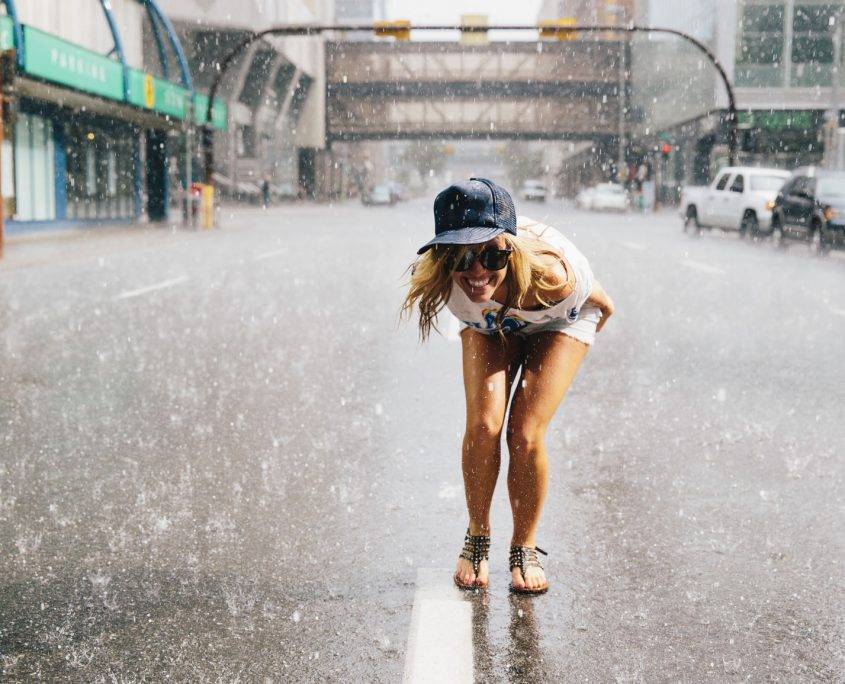Woman Standing In The Street In Rain